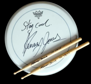 Kenney Jones signed drumhead and drumsticks