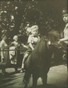 A young Kenney Jones on horseback