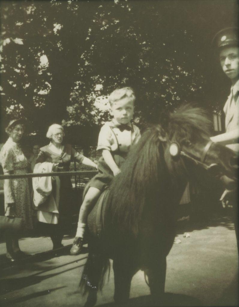 A young Kenney Jones on horseback