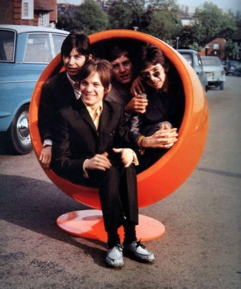 The Small Faces in a 60s chair